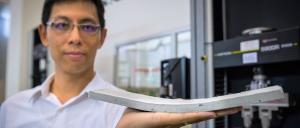 Prof Yang En-Hua with the flexible concrete. Photo: NTU